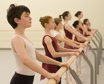 A group of young dancers at the barre
