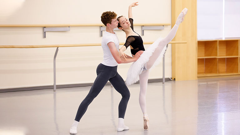 two dancers in ballet class