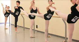 Dancers audition at the barre.