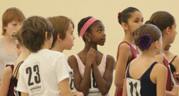 A group of young dancers wait to audition.