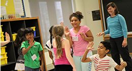 Students learning in the classroom through movement