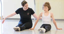 An instructor assists a student in class.
