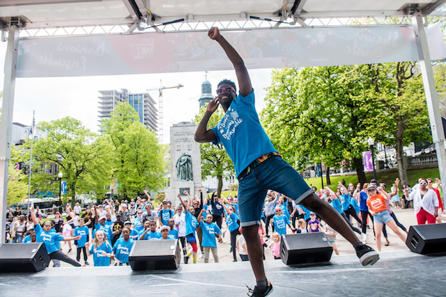 Eugene Baffoe leads a group of dancers at the public dance event, NBS Sharing Dance Day, in Halifax