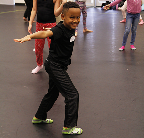 A group of young dancers participating in a dance class