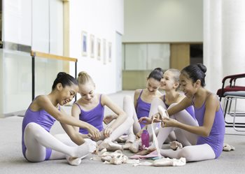 Dancers putting on pointe shoes